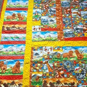 Adorable jungle animals themed quilt.
